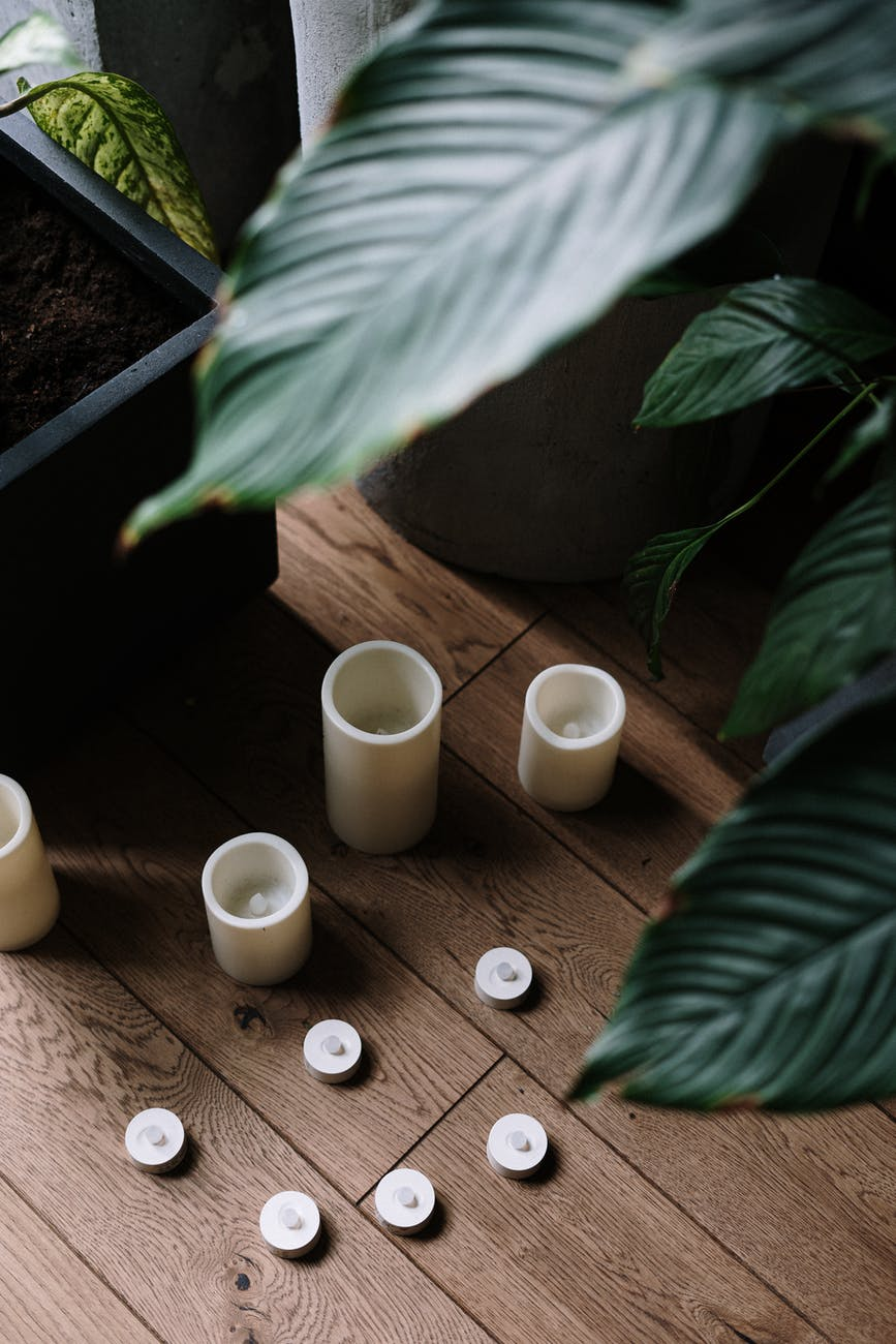 four white ceramic mugs on brown wooden table