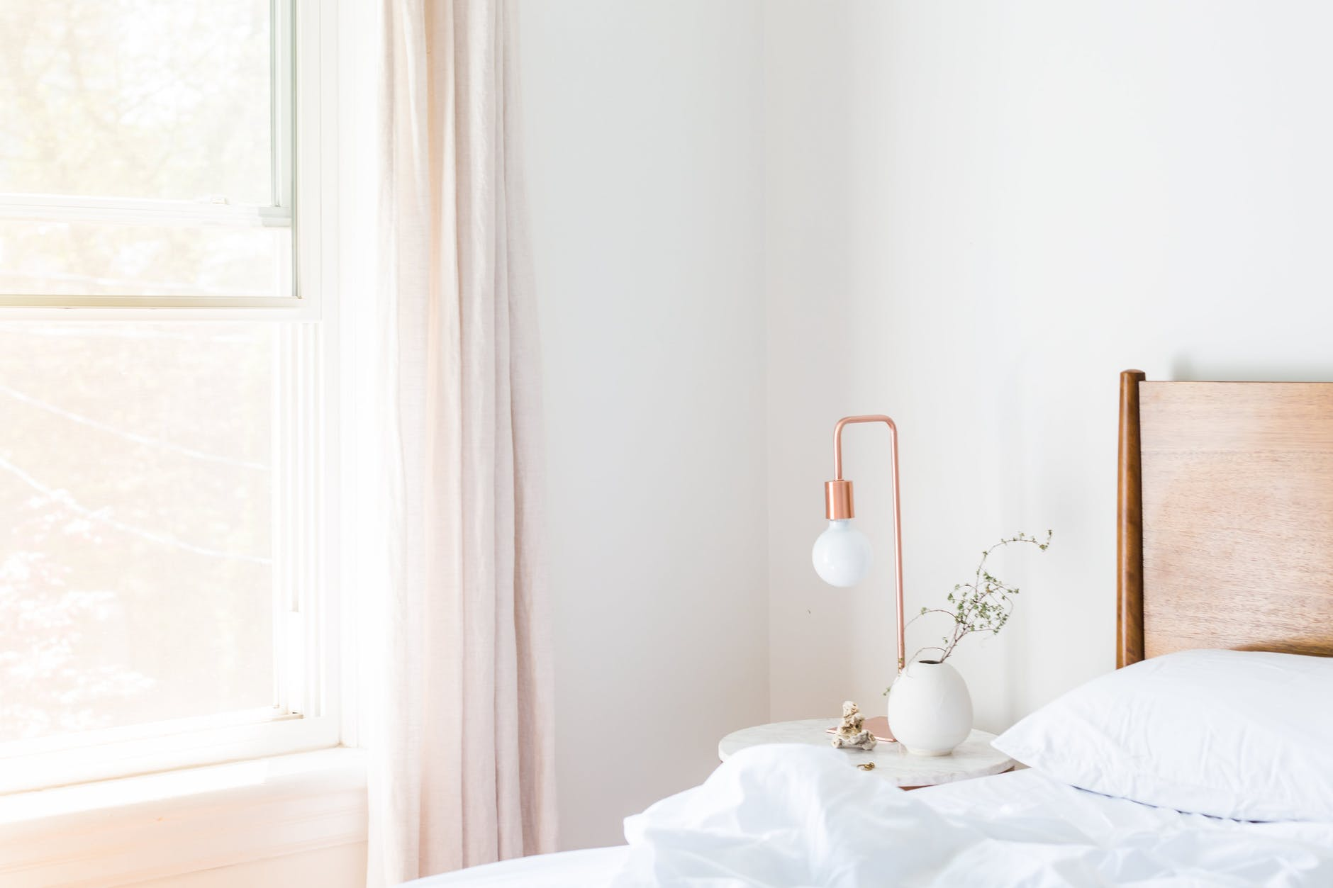 white table lamp and vase on side nightstand